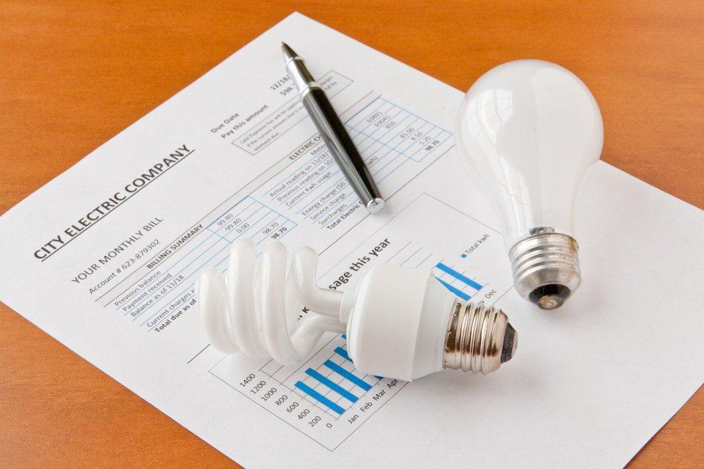 electricity bill and lightbulbs