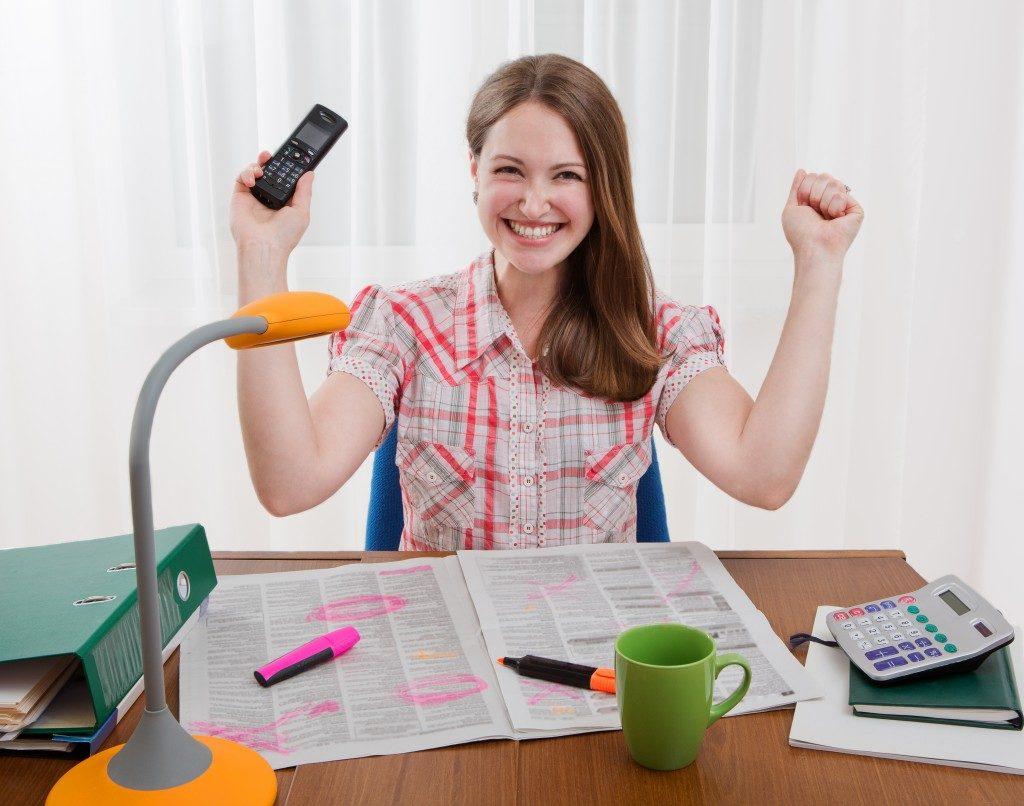woman feeling happy at work