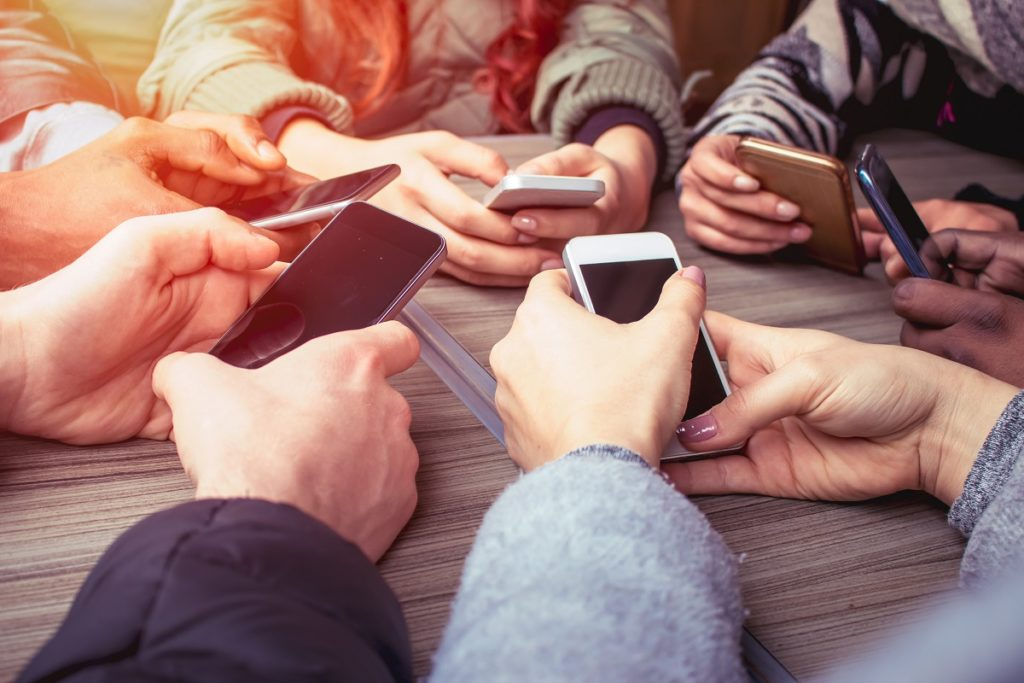 a group of people holding smart phones