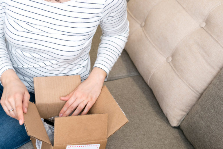 Woman opening package