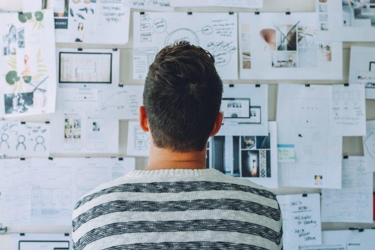 person looking at idea board