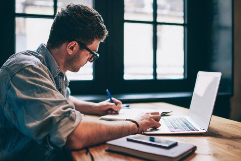 man working laptop writing