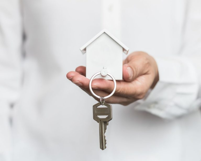 key attached to house figurine